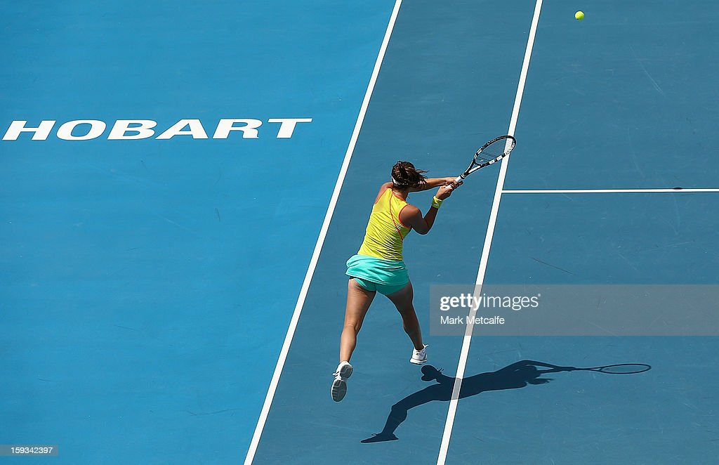 Garbine Muguruza and Maria-Teresa Torro-Flor of Spain in action in their doubles final match against Timea Babos of Hungary and Mandy Minella of Luxembourg during day nine of the Hobart International at Domain Tennis Centre on January 12, 2013 in Hobart, Australia.
