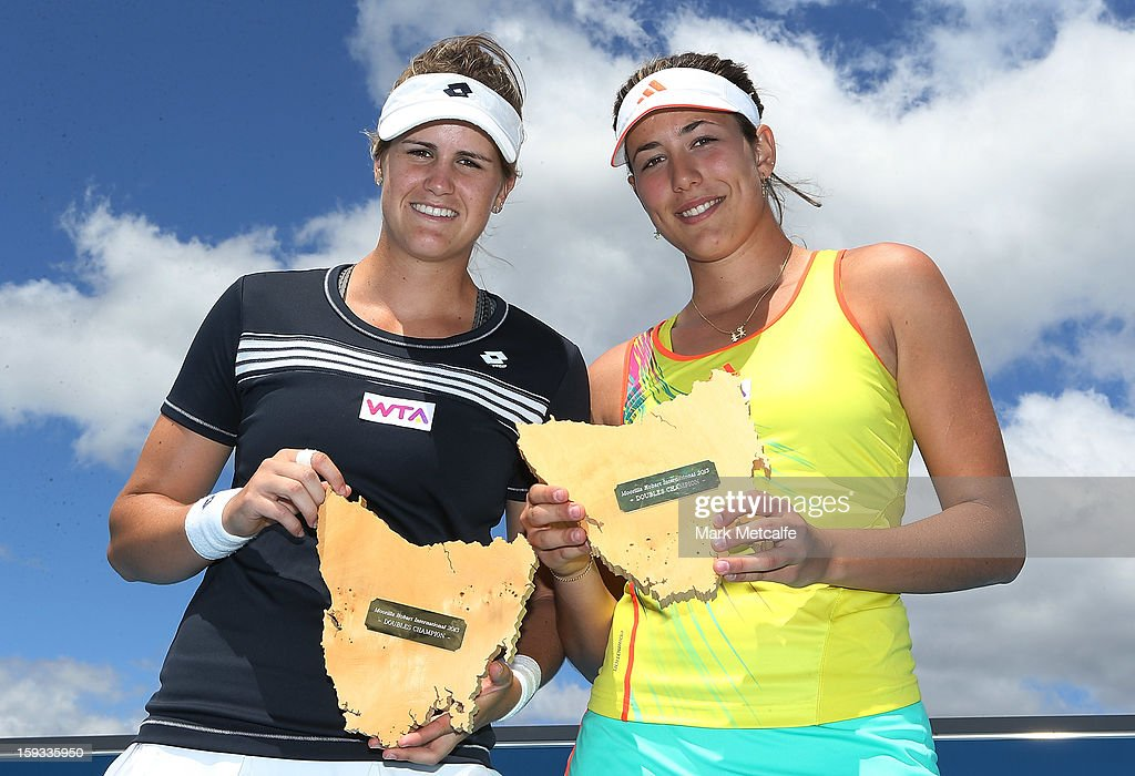 Garbine Muguruza and Maria-Teresa Torro-Flor of Spain pose with the winners trophies after victory in their doubles final match against Timea Babos of Hungary and Mandy Minella of Luxembourg during day nine of the Hobart International at Domain Tennis Centre on January 12, 2013 in Hobart, Australia.