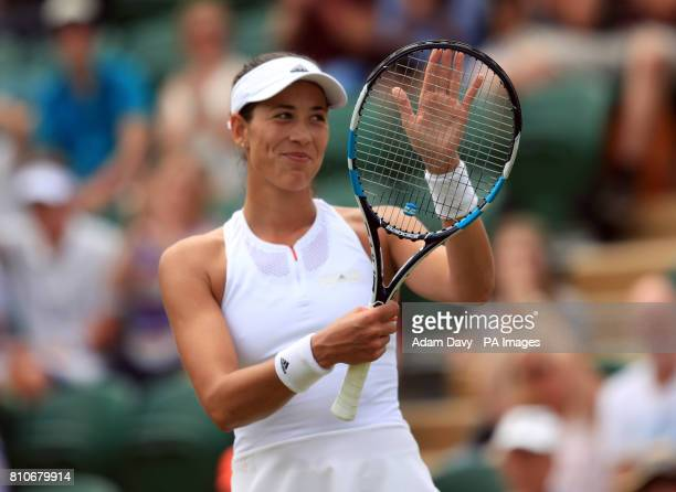 Garbine Muguruza celebrates victory over Sorana Cirstea on day six of the Wimbledon Championships at The All England Lawn Tennis and Croquet Club...