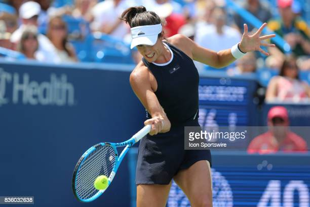 Garbine Muguruza hits a forehand during the championship match against Garbine Muguruza and Simona Halep During the Western Southern Open at the...