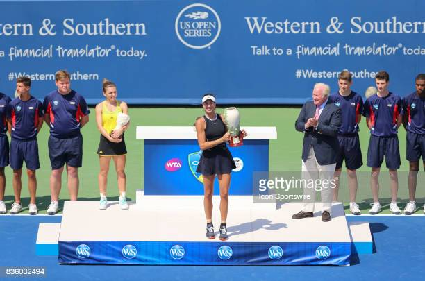 Garbine Muguruza holds the trophy after winning the championship match at the Western Southern Open at the Lindner Family Tennis Center in Mason Ohio...
