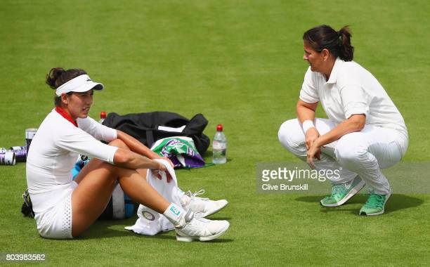 Garbine Muguruza of Spain and coach Conchita Martinez in discussion during practice ahead of Wimbledon Lawn Tennis Championships at the All England...