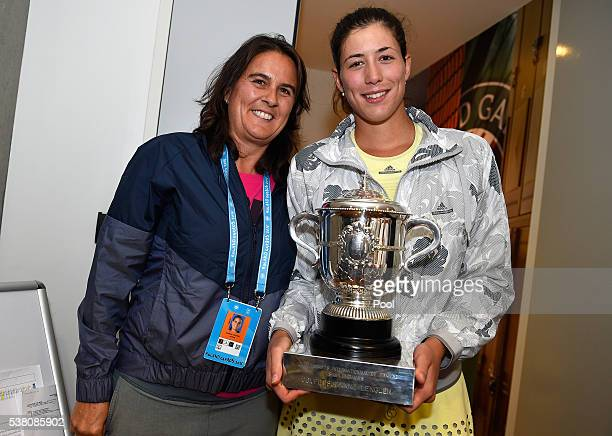 Garbine Muguruza of Spain and Conchita Martinez pose with the trophy following her victory during the Ladies Singles final match against Serena...