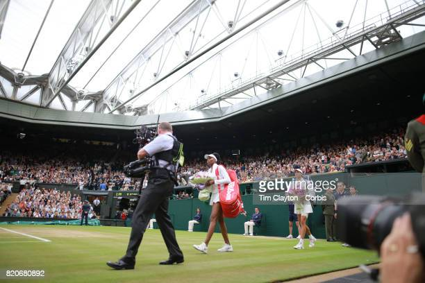 Garbine Muguruza of Spain and Venus Williams of The United States enter Center Court for the Ladies Singles Final match in the Wimbledon Lawn Tennis...
