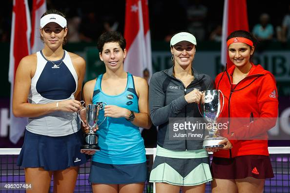 Garbine Muguruza of Spain Carla Suarez Navarro of Spain Martina Hingis of Switzerland and Sania Mirza of India hold up their trophies after thier...