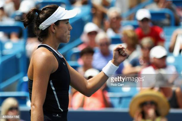 Garbine Muguruza of Spain celebrates after defeating Karolina Pliskova of Czech Republic during Day 8 of the Western and Southern Open at the Linder...