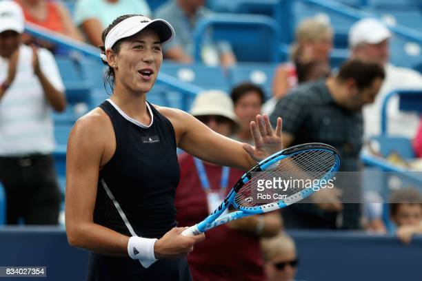 Garbine Muguruza of Spain celebrates after defeating Madison Keys during Day 6 of the Western and Southern Open at the Linder Family Tennis Center on...