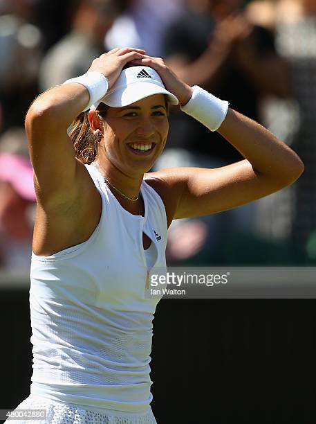 Garbine Muguruza of Spain celebrates after winning the Ladies Singles Semi Final match against Agnieszka Radwanska of Poland during day ten of the...