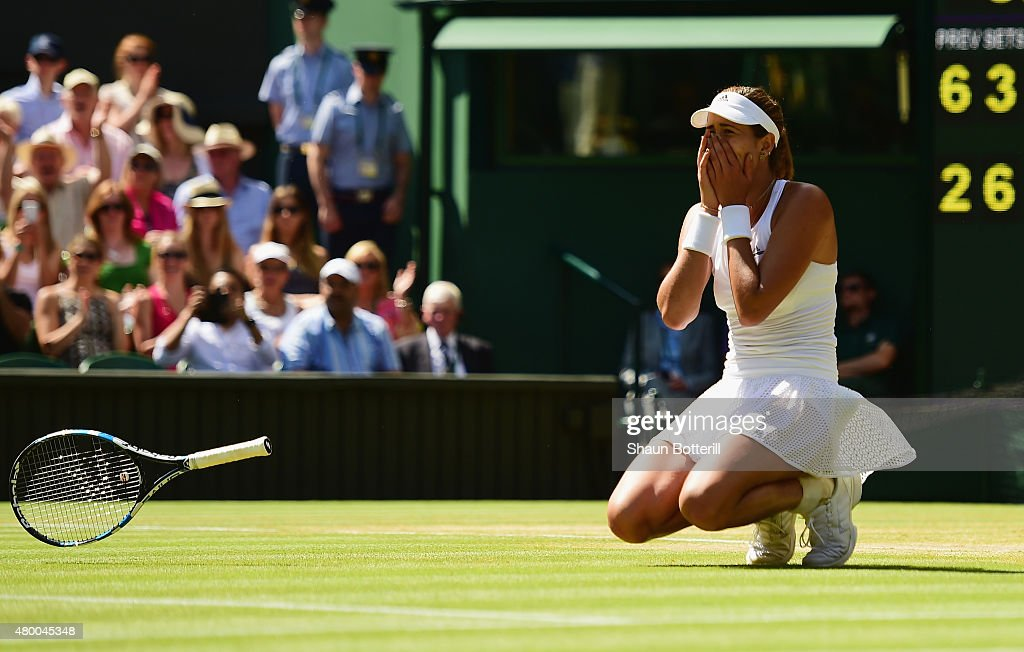 Garbine Muguruza of Spain celebrates after winning the Ladies Singles Semi Final match against Agnieszka Radwanska of Poland during day ten of the Wimbledon Lawn Tennis Championships at the All England Lawn Tennis and Croquet Club on July 9, 2015 in London, England.