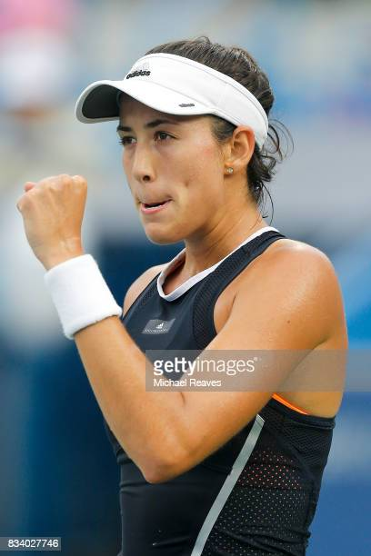 Garbine Muguruza of Spain celebrates against Madison Keys of the United States during Day 6 of the Western and Southern Open at the Lindner Family...