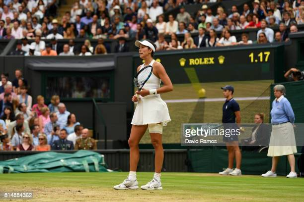Garbine Muguruza of Spain celebrates championship point and victory as the hawk eye challenge rules in her favour during the Ladies Singles final...