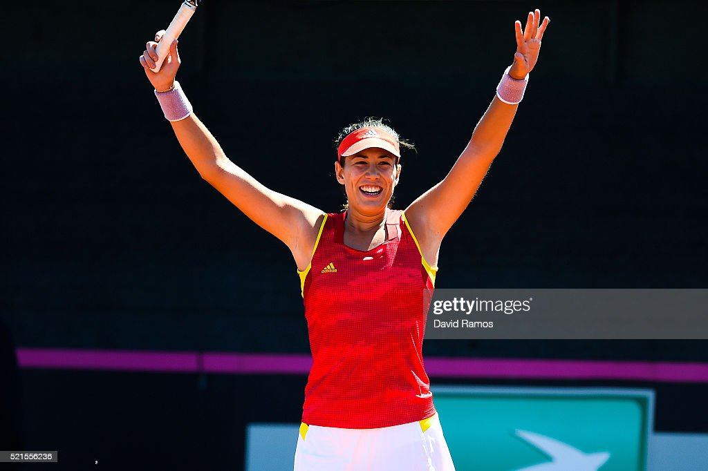Garbine Muguruza of Spain celebrates defeating Francesca Schiavone of Italy during day one of the Fed Cup World Group Play-off Round match between Spain and Italy on April 16, 2016 in Lleida, Spain.