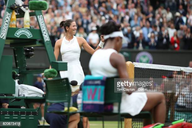 Garbine Muguruza of Spain celebrates her victory in the Ladies Singles final watched by Venus Williams of The United States during the Wimbledon Lawn...