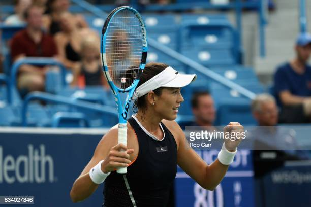 Garbine Muguruza of Spain celebrates match point after defeating Madison Keys during Day 6 of the Western and Southern Open at the Linder Family...