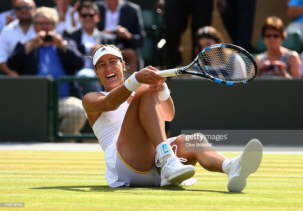 Garbine Muguruza of Spain celebrates match point in her Ladies Singles Quarter Final match against Timea Bacsinszky of Switzerland during day eight of the Wimbledon Lawn Tennis Championships at the All England Lawn Tennis and Croquet Club on July 7, 2015 in London, England.
