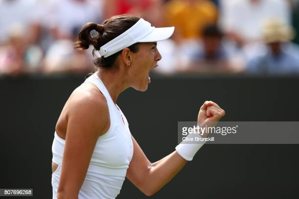 Garbine Muguruza of Spain celebrates victory after the Ladies Singles first round match against Ekaterina Alexandrova of Russia day two of the...