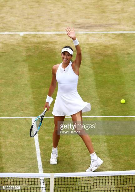 Garbine Muguruza of Spain celebrates victory after the Ladies Singles quarter final match against Svetlana Kuznetsova of Russia on day eight of the...