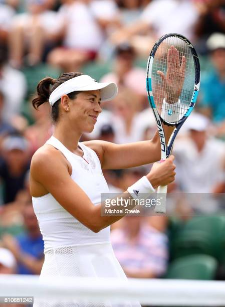 Garbine Muguruza of Spain celebrates victory during the Ladies Singles third round match against Sorana Cirstea of Romania on day six of the...