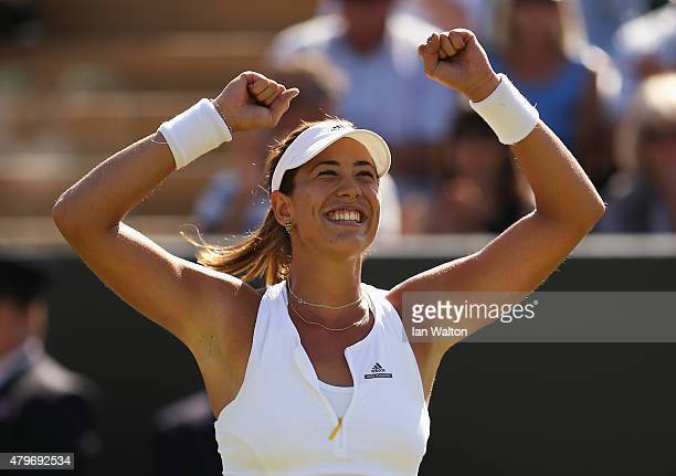 Garbine Muguruza of Spain celebrates victory in her Ladies' Singles Fourth Round match against Caroline Wozniacki of Denmark during day seven of the...