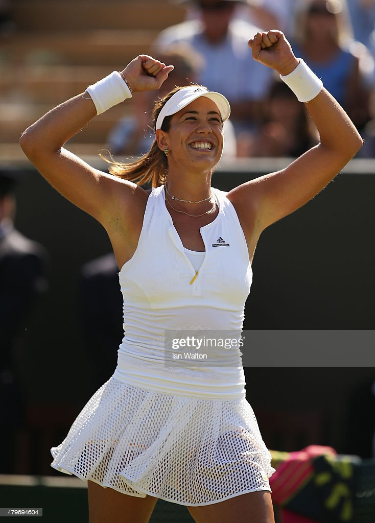 Garbine Muguruza of Spain celebrates victory in her Ladies' Singles Fourth Round match against Caroline Wozniacki of Denmark during day seven of the Wimbledon Lawn Tennis Championships at the All England Lawn Tennis and Croquet Club on July 6, 2015 in London, England.