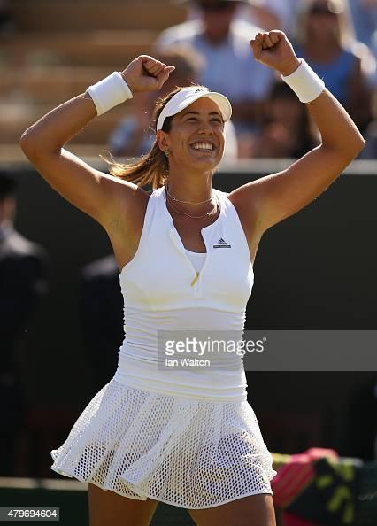 Garbine Muguruza of Spain celebrates victory in her Ladies' Singles Fourth Round match against Caroline Wozniacki of Denmark during day seven of the...