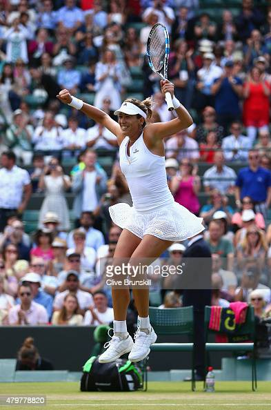 Garbine Muguruza of Spain celebrates victory in her Ladies Singles Quarter Final match against Timea Bacsinszky of Switzerland during day eight of...