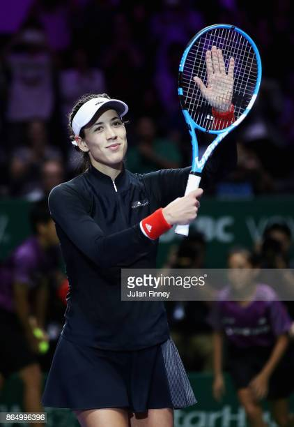 Garbine Muguruza of Spain celebrates victory in her singles match against Jelena Ostapenko of Latvia during day 1 of the BNP Paribas WTA Finals...