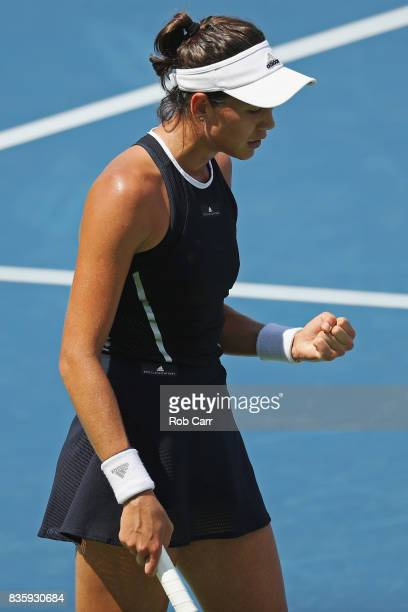 Garbine Muguruza of Spain celebrates winning a point against Simona Halep of Romania during Day 9 of the women's final of the Western and Southern...