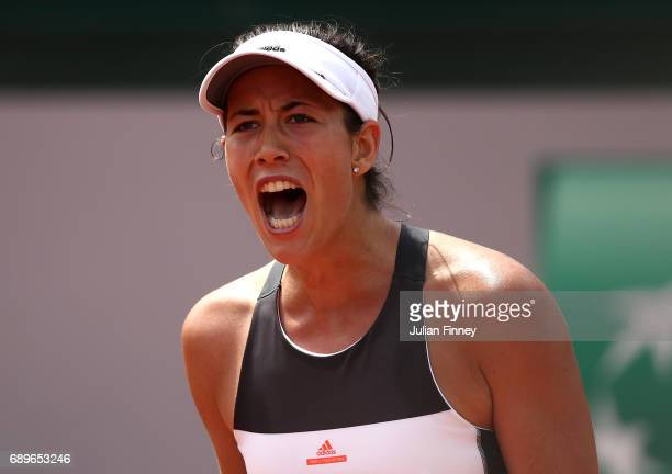 Garbine Muguruza of Spain celebrates winning a point during the first round match against Francesca Schiavone of Italy on day two of the 2017 French...