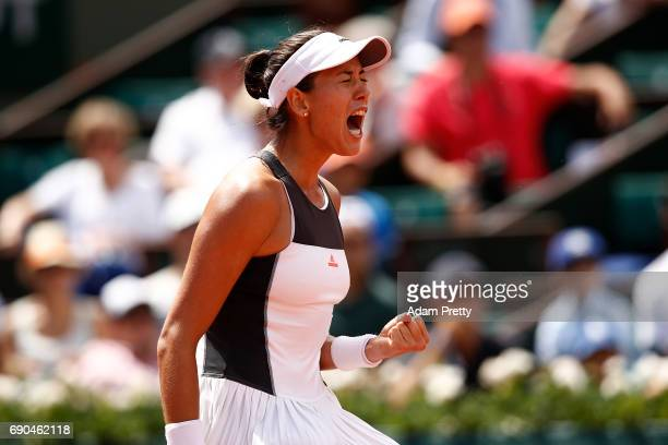 Garbine Muguruza of Spain celebrates winning a point during the second round match against Anett Kontaveit of Estonia on day four of the 2017 French...