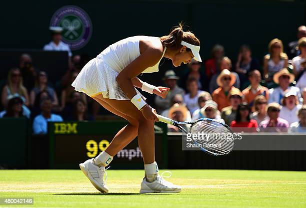 Garbine Muguruza of Spain celebrates winning a point in the Ladies Singles Semi Final match against Agnieszka Radwanska of Poland during day ten of...
