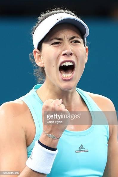 Garbine Muguruza of Spain celebrates winning her quarter final match against Svetlana Kuznetsova of Russia during day five of the 2017 Brisbane...