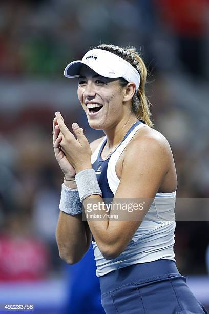 Garbine Muguruza of Spain celebrates winning the Women's Single Final match against Timea Bacsinszky of Switzerland on day 9 of the 2015 China Open...