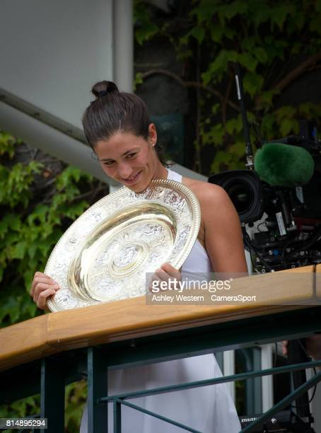 Garbine Muguruza of Spain celebrates with the Venus Rosewater Dish after her victory over Venus Williams of United States in their Ladies' Singles...