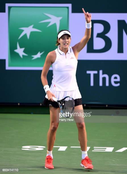 Garbine Muguruza of Spain challenges match point to beat Elina Svitolina of Ukraine during the BNP Paribas Open at Indian Wells Tennis Garden on...