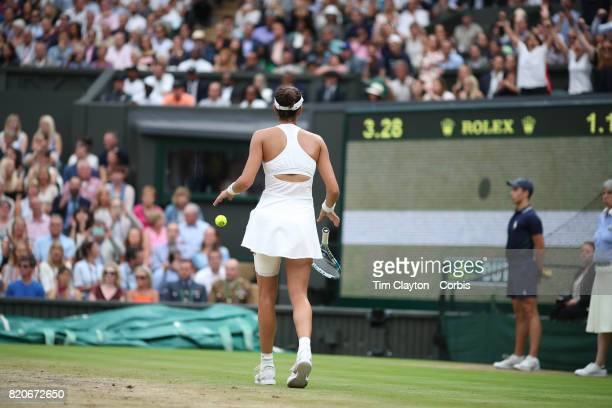 Garbine Muguruza of Spain falls to her knees as the video replay confirms her victory in the Ladies Singles final against Venus Williams of The...