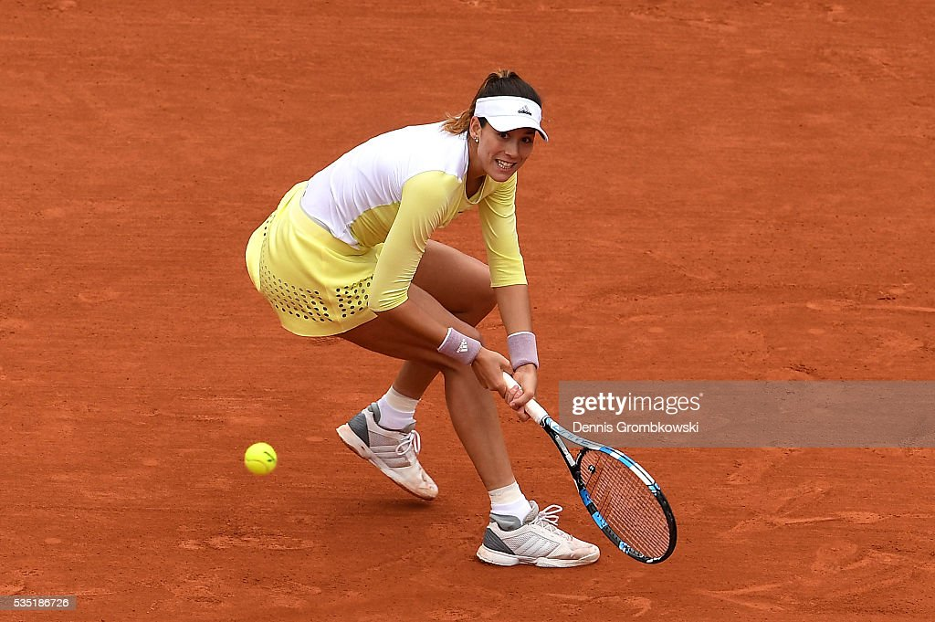 Garbine Muguruzu of Spain hits a backhand during the Ladies Singles fourth round match against Svetlana Kuznetsova of Russia on day eight of the 2016 French Open at Roland Garros on May 29, 2016 in Paris, France.