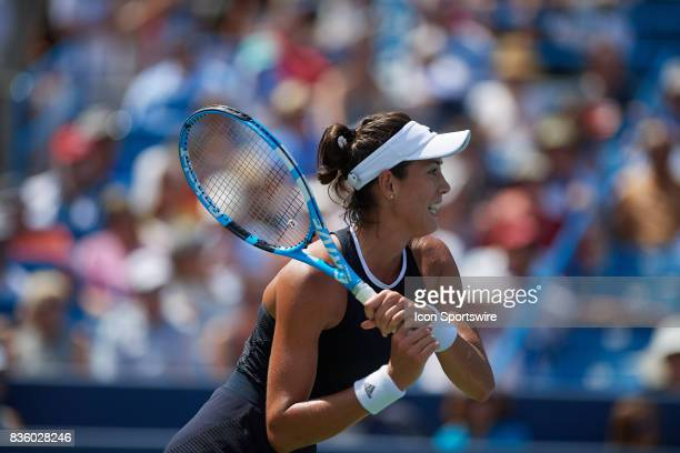 Garbine Muguruza of Spain hits a backhand to Simona Halep of Romania during the ladies finals in the Western Southern Open at the Lindner Family...