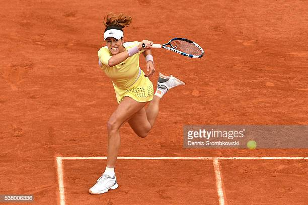 Garbine Muguruza of Spain hits a forehand during the Ladies Singles final match against Serena Williams of the United States on day fourteen of the...