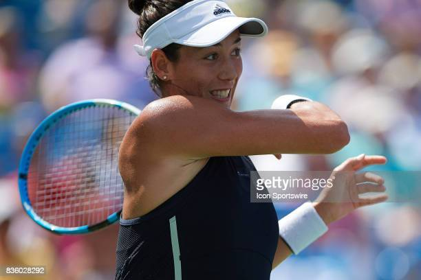 Garbine Muguruza of Spain hits a forehand to Simona Halep of Romania during the ladies finals in the Western Southern Open at the Lindner Family...
