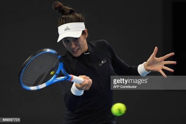 Garbine Muguruza of Spain hits a return during her women's singles match against Barbora Strycova of the Czech Republic at the China Open tennis...
