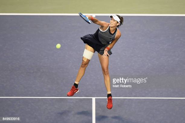 Garbine Muguruza of Spain hits an overhead volley against Monica Puig of Puerto Rico during day three of the Toray Pan Pacific Open Tennis At Ariake...