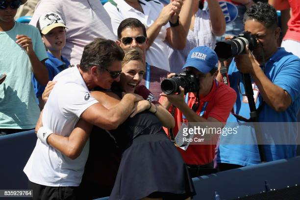 Garbine Muguruza of Spain hugs family members after defeating Simona Halep of Romania to win the women's final of the Western and Southern Open at...