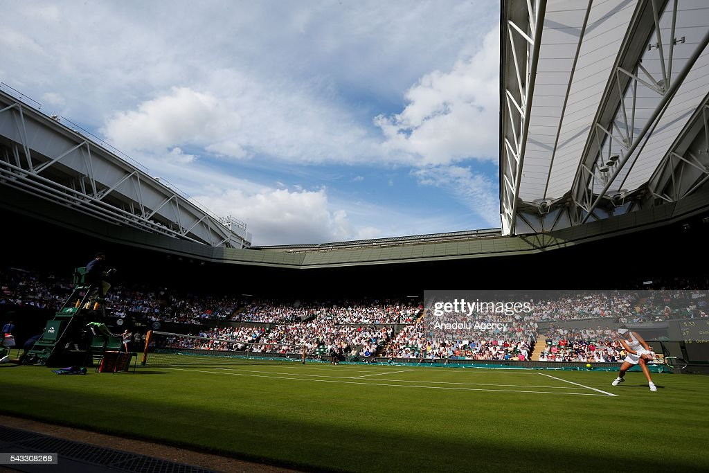 Garbine Muguruza of Spain in action against Camilla Giorgi of Italy in the womens' singles on day one of the 2016 Wimbledon Championships at the All England Lawn Tennis and Croquet Club in London, United Kingdom on June 27, 2016.