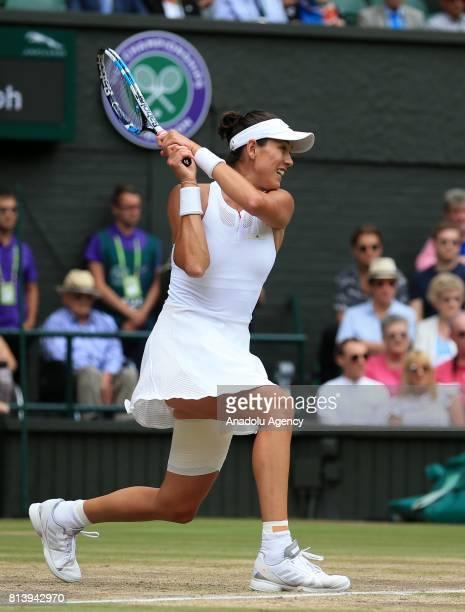 Garbine Muguruza of Spain in action against Magdalena Rybarikova of Slovakia during the women's semifinal on day ten of the 2017 Wimbledon...
