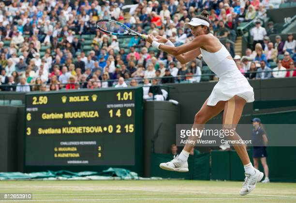 Garbine Muguruza of Spain in action during her victory over Svetlana Kuznetsova of Russia in their Ladies' Quarter Finals Match at Wimbledon on July...