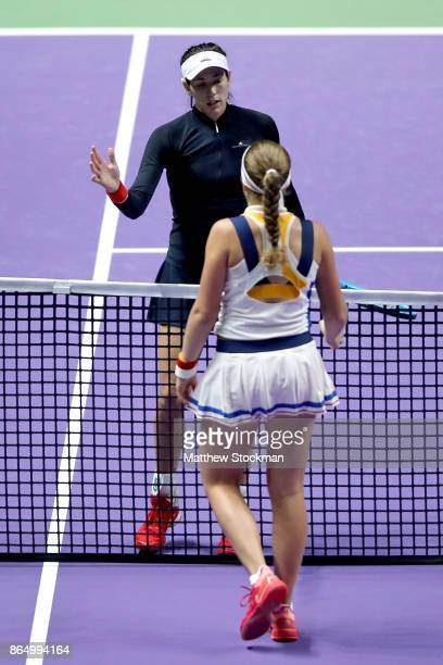Garbine Muguruza of Spain is congratulated by Jelena Ostapenko of Latvia after their match during day 1 of the BNP Paribas WTA Finals Singapore...