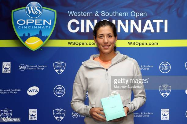 Garbine Muguruza of Spain is presented a special gift from the USTA after her win over Simona Halep of Romania during the women's final on day 9 of...