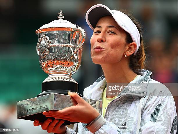 Garbine Muguruza of Spain kisses the trophy following her victory during the Ladies Singles final match against Serena Williams of the United States...