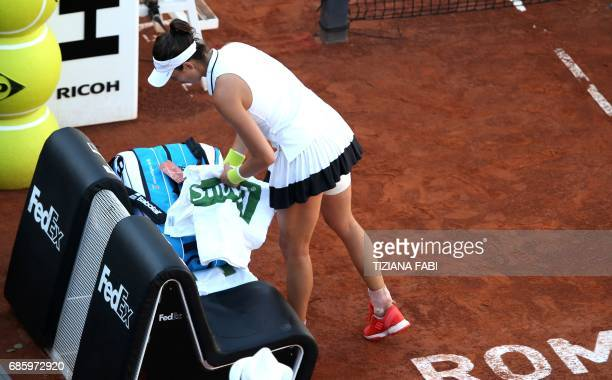 Garbine Muguruza of Spain leaves the court after an injury during her semifinal match against Elina Svitolina of Ukraine at the WTA Tennis Open...